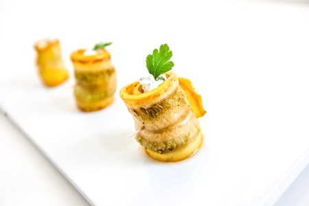 Grilled zucchini rolls stuffed with cream cheese, pickles, capers and herbs 스톡 콘텐츠