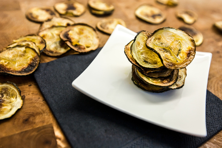 Plate of a homemade roasted zucchini chips