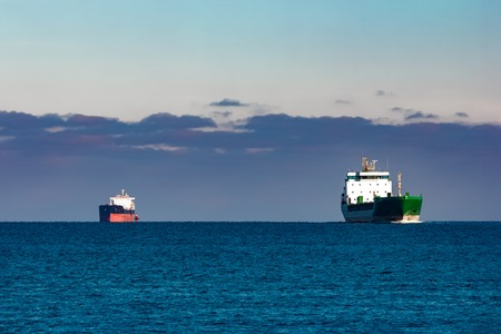 Cargo ships far in still water of Baltic sea