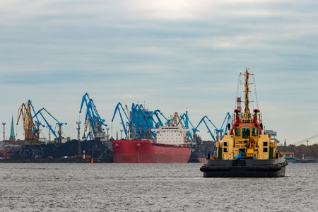 Tug ship in the cargo port of Riga, Europe