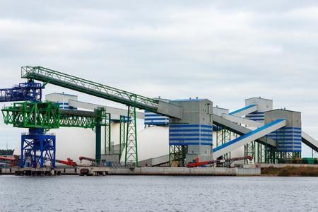 Fertilizer terminal in Riga, big white storage tanks