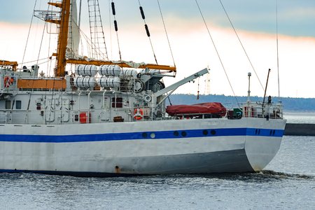 White sailing ship coming from Baltic sea and entering Riga Stock Photo