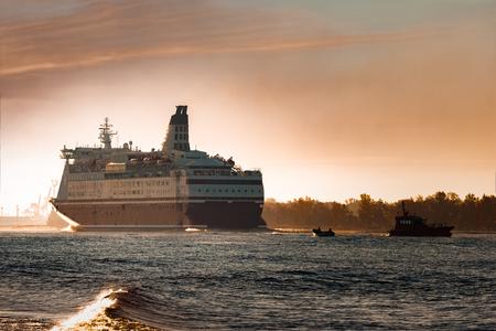 Big cruise liner. Passenger ferry ship entering Riga at morning Stock Photo