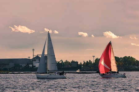 cinematic: Sailboat regatta on Daugava river. Yachts sailing in Riga