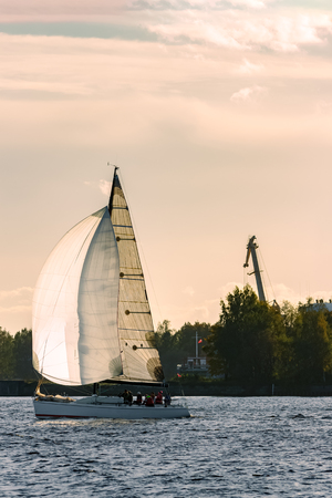 cinematic: Sailboat moving on Daugava river in evening, Latvia Stock Photo
