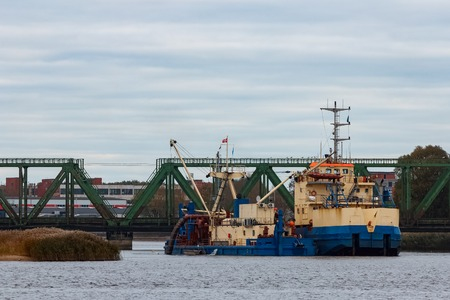 Blue cargo ship in the port of Riga, Europe