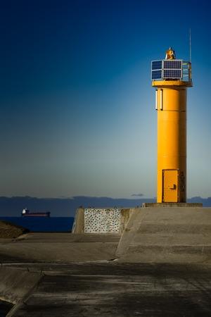 mare agitato: Yellow lighthouse on breakwater dam in Riga, Europe