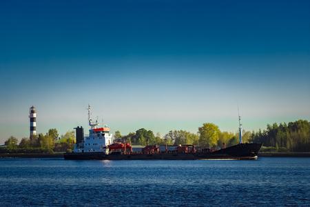 Black cargo oil tanker entering the port of Riga at sunny day Stock Photo
