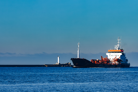 sustancias toxicas: Black cargo oil tanker sailing in still water from Baltic sea
