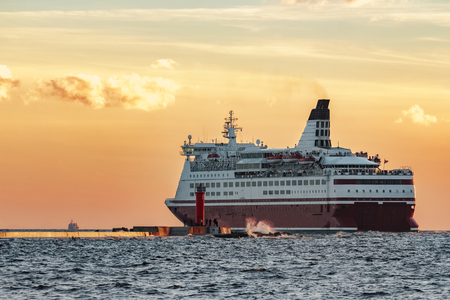Red cruise liner. Passenger ferry sailing from Riga to Stockholm Stock Photo