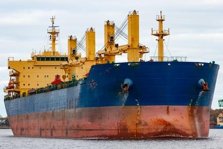 piloting: Blue cargo ship entering the port of Riga, Europe Stock Photo