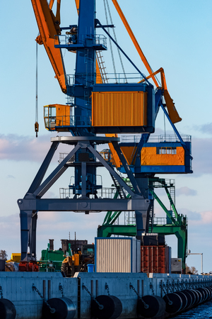 Yellow cargo cranes in the port of Riga, Europe