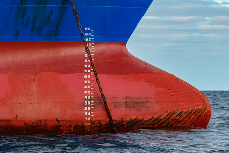 Blue cargo ship moored in still Baltic sea water Stock Photo
