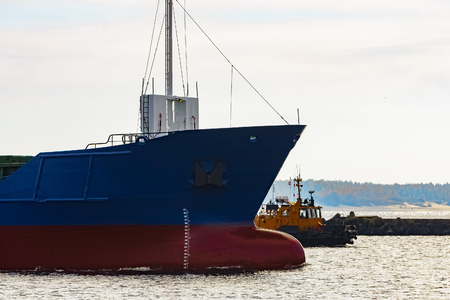Blue cargo ships bow leaving the port of Riga Stock Photo