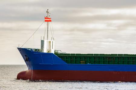 bulk: Blue cargo ships bow leaving the port of Riga Stock Photo