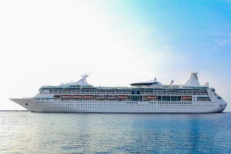 ship bow: White cruise ship underway. Passenger ship leaving port of Riga Stock Photo