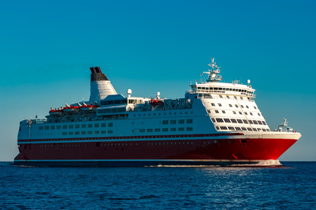 Red cruise liner. Large passenger ferry underway