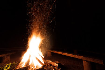 burned out: Campfire with flying sparks in the night Stock Photo