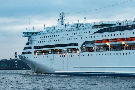 first day: White cruise liner. Passenger ferry moving in still water Stock Photo