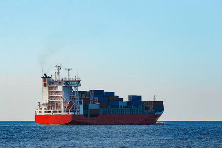 Red container ship sailing to the Baltic sea