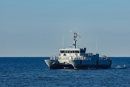 Small grey military ship moving from Baltic sea