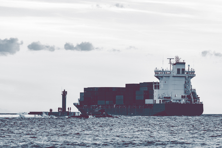 cinematic: Full container ship leaving Riga and entering Baltic sea