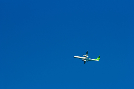 Passenger aircraft flying in the blue sky Stock Photo