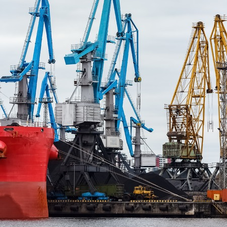 warehouse: Blue cargo cranes in the port of Riga, Europe Stock Photo