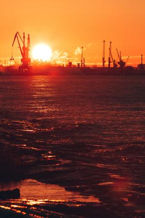 Hot winter sunrise over the cargo port in Riga