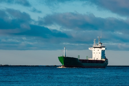 Green bulk carrier sailing from the Baltic sea Stock Photo