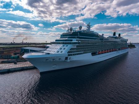 ship anchor: Big white passenger ship moored at the cargo port Stock Photo