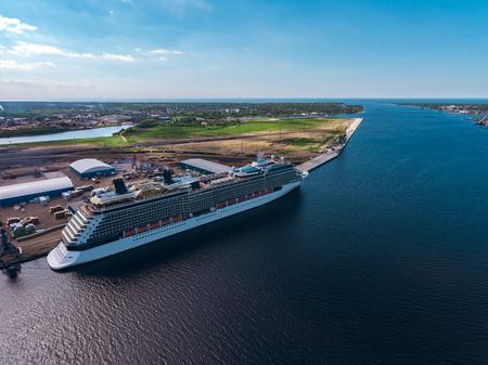 Big white passenger ship moored at the cargo port Banco de Imagens