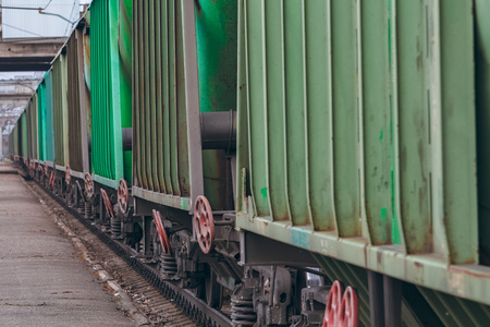 freight train: Green cargo wagons. Freight train in action Stock Photo