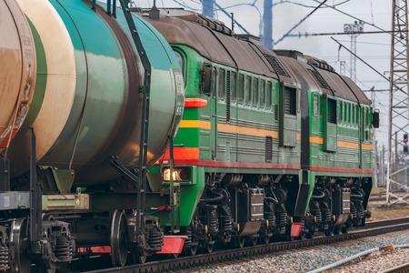 heavy industry: Green diesel cargo locomotive. Freight train in action
