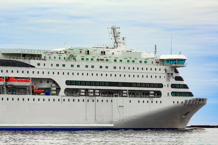 royals: White cruise liner sailing on a clear day