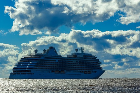 royals: Big white cruise ship sailing to the Baltic sea at clear day