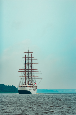 Big white sailing ship with three mast moving to the Riga port