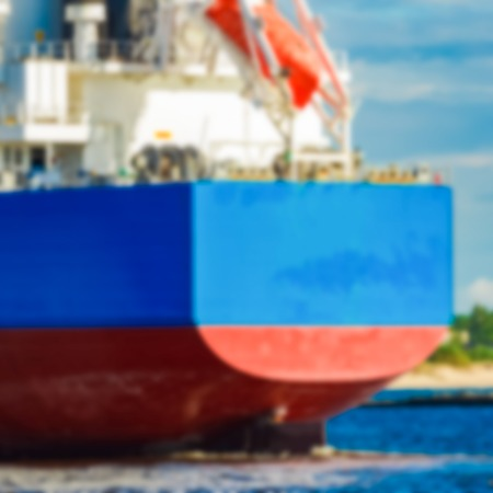 Blue cargo ship - soft lens bokeh image. Defocused background