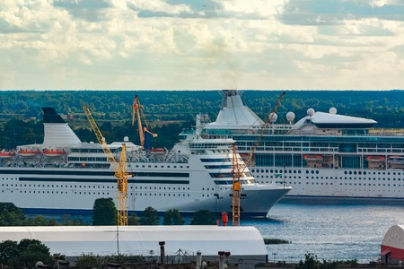 Two cruise liners in Riga. Tour travel and spa services