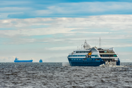 Small blue passenger ship sailing in Baltic sea. Spa services Stock Photo
