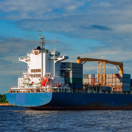 Blue container ship. World logistics and production transfer Stock Photo