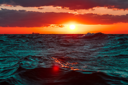 Waves in the ocean against hot and romantic sunset