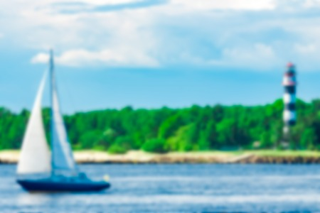 Blue sailboat - soft lens bokeh image. Defocused background