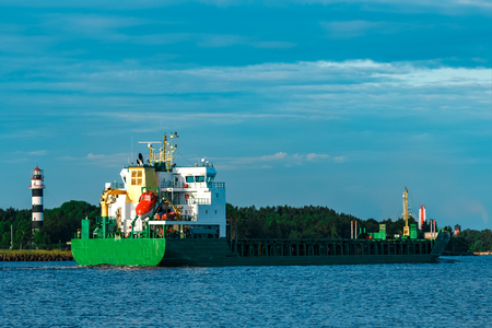 Green bulker ship. Logistics and merchandise transportations