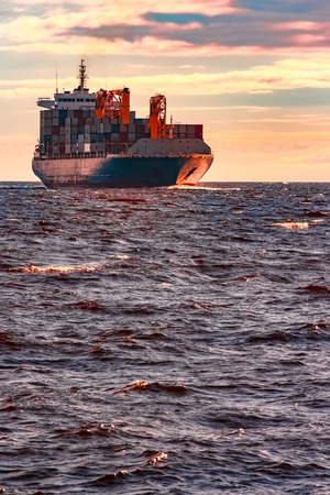 Blue container ship. World logistics and production transfer Stock fotó