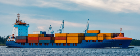 Blue container ship. Global logistics and merchandise transfer Stock Photo