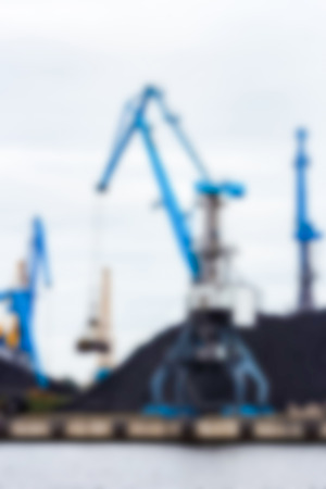 Portal cargo cranes - soft lens bokeh image. Defocused background Stock Photo