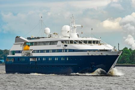 Small blue passenger ship sailing in Baltic sea. Spa services Archivio Fotografico