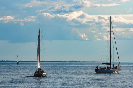 A fiew sailboats are traveling in Baltic sea. Summer journey Stock Photo