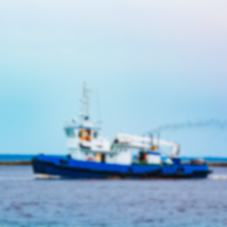 Tug ship - soft lens bokeh image. Defocused background